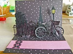 Eiffel Tower cut from Cricut Destinations. Bike, railing, lampsost, and tres are from Cricut Heritage.