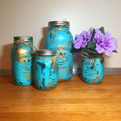 """This gold flecked aqua/turquoise 4 piece painted mason jar kitchen gift set, complete with flower vase, adds the perfect rustic charm to your kitchen. Our unique colours add a gorgeous pop of colour to your home and pull their weight when organizing your kitchen items. The lids are covered in a beautiful jute/burlap fabric.     PLUS: Is this a gift? Are you short on time? Choose to receive the set pre-gift wrapped FOR FREE! Just select """"gift wrapped"""" in the packaged drop down menu. No other…"""