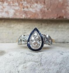 Antique Art Deco Diamond Sapphire Halo Pear Teardrop Marquise Engagement Ring Video on Instagram: https://www.instagram.com/p/BXGLwDYhCF6/?taken-by=cypresscreekvintage Set into solid platinum, this is true, one-of-a-kind ring from the 1920s. This halo ring features a cluster of
