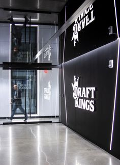 Interior branding for the new DraftKings Boston HQ. Dimensional wall letters with layered acrylic. Design by IA Interior Architects. Engineered, built and installed by Design Communications Ltd. Letter Wall, Letters, Interior Architects, Wall Logo, Environmental Graphics, Black Walls, Signage, Boston, Branding