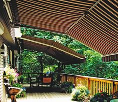 Retractable Awnings with the Marcesa Feature offer much higher headroom to open up your outdoor patio space. Retractable awnings can be motorized with Somfy Motors.
