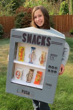 Thrifty and Thriving made an adorable Candy Vending Machine Costume.  featured on LivingLocurto.com #halloween