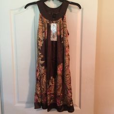 Dress This brown with pink, beige, and lighter brown flowery detail silk like dress (or top depending on your height) is very boho chic.  Dresses