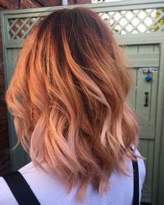 Peach hair with a dark root stretch
