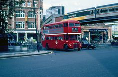 Shepherds Bush Green 1986. I live behind where the photographer stood to take the picture. I miss the sky train!