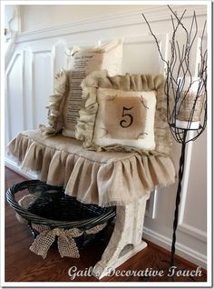 Love the basket with burlap woven through it and those CUTE pillows