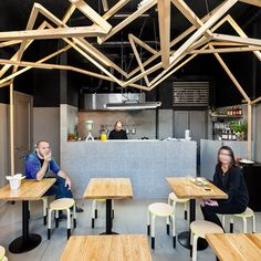 Thai noodle bar with a tree-like wooden canopy by Moko Architects