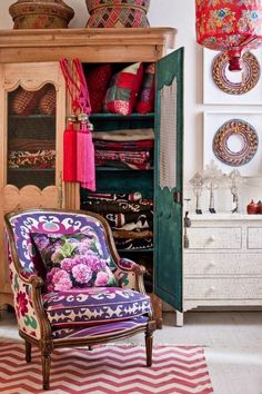 Room Inspiration:  vibrant boho armchair and rattan colourful baskets above your antique cabinet.