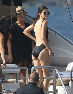 Kendall Jenner displays her pert posterior in racy backless swimsuit #dailymail