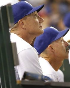 Texas Rangers manager Jeff Banister (28) and pitching coach Mike Maddux (31) watch the flight of a pop up during the Boston Red Sox vs. the Texas Rangers major league baseball game at Globe Life Park in Arlington on Thursday, May 28, 2015. (Louis DeLuca/The Dallas Morning News)