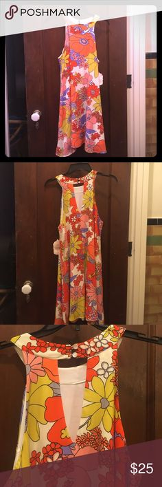 """Altar' State 60s Style Halter Dress NWT Halter dress in """"Atlanta-Retro"""" (coral, orange, yellow, pink, and purple flowers on an ivory background). Lined. Double button closure at neck with v-shaped cutout below. 100% polyester. Size Medium. New with tags from Altard State. Altar'd State Dresses Strapless"""