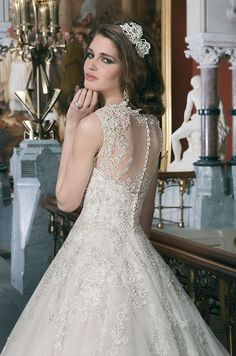 Beaded embroidered and corded lace tulle ball gown features a Sabrina illusion neckline. Justin Alexander, 2014