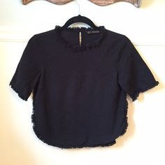 """Zara Sz S Curved Hem Top Fringe Frayed Trim Black  Zara   Curved hem top with frayed edge trim   Size Small   Excellent used condition!   Cotton   Bust: 17"""" across the front, lying flat.    Length: 21"""" from shoulder to hem.  ✳️ Bundle to Save 20%!  ❌ No Trades, Holds, PP, Modeling  100% Authentic!    Suggested User • 1000+ Sales • Fast Shipper • Best in Gifts Party Host!  Zara Tops"""