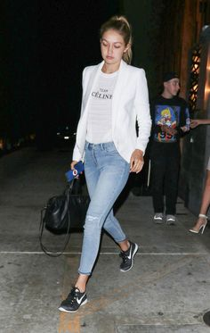 The more we see of Gigi Hadid, the more we love this long-time Guess girl. We love how she paired her Team Celine tank ($49 at bossastore.com.au) with a white Smythe Anytime Blazer ($595, shopnyla.c...