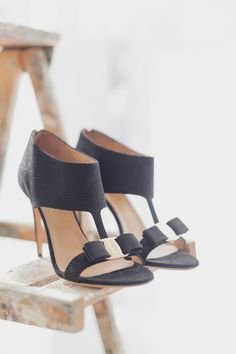 Black Ferragamo sandals with grosgrain Vara bows
