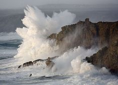 Enormous waves - that's a building on top of the cliff