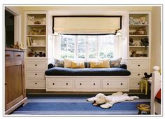 window seat  like the idea for the bed and storage in a small space and the light sconces on either side