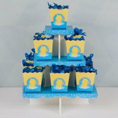 """Ducky Duck - Candy Stand & 13 Candy Boxes by Big Dot of Happiness, LLC. $19.99. The 13 individual empty candy boxes are 2.75"""" high by 3"""" wide. (these ship flat a little assembly is required). Bottom tier is 9.75"""" holds 8 candy boxes x Middle tier is 6.75"""" holds 4 candy boxes x Top tier is 3.75"""" holds 1 candy box.. Stand is meant for one time use! It is made out sturdy foam board and comes with decorative themed card stock covers.. **Please note, CANDY (shown i..."""