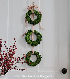 Christmas Boxwood Wreath door hanging via Town and Country Living