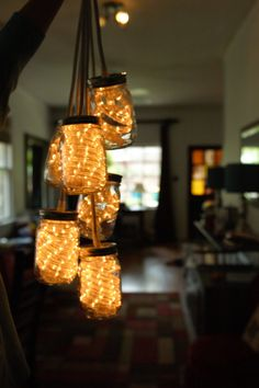 Mason Jar Light Fixture by StevenVeach on Etsy, $15.00 ~ love the rope lights instead of a single light