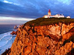"""Cabo da roca, Lisboa - PORTUGAL. A cape which forms the westernmost extent of continental Europe (and by definition the Eurasian land mass). Cabo da Roca was known to the Romans as 'Promontorium Magnum' and during the Age of Sail as the Rock of Lisbon. The 16th century Portuguese poet Luís de Camões described it as """"where the land ends and the sea begins""""."""
