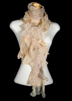 I don't know what Nunofelt Silk is, but apparently it makes a very gorgeous (and pricey) scarf!