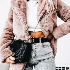 Fuzzy blush pink coat + white sweater cropped + light wash denim jeans + black belt. Winter outfit idea, perfect casual street wear.