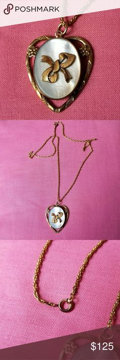 Vintage gold filled locket bow and mother of pearl This gorgeous golden old heart shaped locket has an charming design with a mother of pearl sea shell disc and a bow in the center. It was made by the Providence Stock Company, likely in the 1920s. Includes chain! The locket part opens from the back and clicks securely shut. Signed PR.ST.CO 1/20-12K G.F. ON STERLING. It is in very nice condition with normal patina, and is from a smoke free home:)   81888BOW8F7F Vintage Jewelry Necklaces