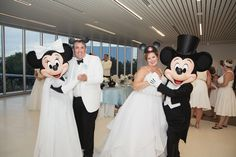 Disney Fairy Tale Wedding couple dance with Mickey and Minnie at their reception in the GM Lounge at Epcot