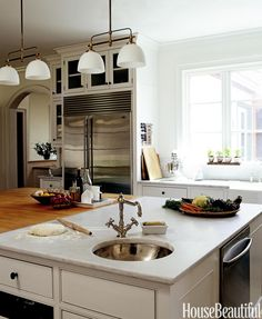 """Carole Lalli, former editor in chief of Food & Wine magazine, designed this butcher-block-and-marble island in her Connecticut kitchen. """"The really large island is because my daughters cook with me when they visit, and my husband is America's best prep cook."""" - HouseBeautiful.com"""