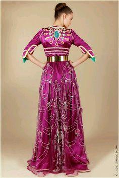 Myriam Belkhayat's. Berry colorer takshita with a gold belt