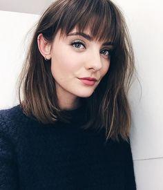 Shoulder-length hair with full bangs/fringe