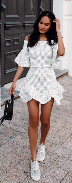 #spring #outfits woman wearing white off-shoulder dress holding black leather bag near a brown door at daytime. Pic by @prettyfrowns