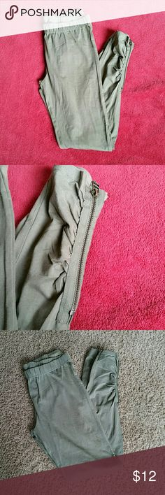 B1G1 FREE Army green leggings w/zipper detail 95% cotton,  5% spandex. Zipper detail on both legs at bottom. Slight piling, but otherwise in great condition!  Buy 1 item and get 1 of equal or lesser value for free! Just bundle your two items and offer the amount of the higher priced item! Now through Monday March 13th! This includes ALL items! eye candy Pants Leggings