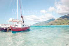 Honeymoon couple during a private catamaran cruise in Moorea, French Polynesia http://www.svphotograph.com    Destination Wedding Photographers. Discover the most beautiful place of this island with your photographer team! #svphotograph #mooreaphotographer #travelphotographer #frenchpolynesia #catamarancruise #moorea #Tahiti #photographer  #romanticcruise