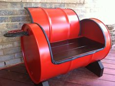 SWEET SEAT -  A cozy, functional, recycled work of art. These benches are made of upcycled 55 gallon drums lined with recycled bike tubes. The seat and base are fabricated from recycled wood from a deck, the drink holder is made from bike chain rings balanced by a bike pedal.