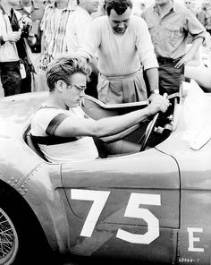 "James Dean, photographed driving his ""Little Bastard"" Silver Porsche 550 Spyder (1955)"