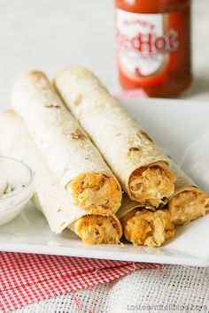 Baked Buffalo Chicken Taquitos | INGREDIENTS  4 ounces cream cheese, softened 1/8 cup buffalo sauce 1 cup shredded Monterey jack cheese 1/8 cup blue cheese crumbles 1 can (12.5-ounce) Swanson® Premium Chunk Chicken Breast in Water, drained 8 8-inch flour tortillas coarse Kosher salt (Thinking I'm going to ditch the bleu cheese and pressure cook real chix breasts)