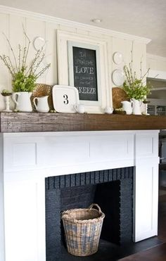 White molding around fireplace, use old barn wood for mantel, maybe find old brick for around fireplace too? fabuloushomeblog.com. Fireplace idea