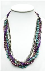 Violet Dream:  Multi-colored chains woven with purple ribbons, turquoise and violet fresh-water pearls will delight your senses.  Length: 33.5 in/85 cm.   *Note: This is a special edition item that ships directly from Thailand. Please allow two to three weeks for delivery. Made by the women in #Nightlight who are survivors of the sex trade industry