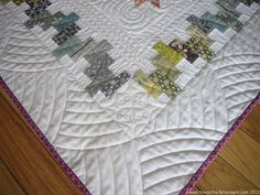 THE QUILTED PINEAPPLE: BOUNCE--LOVE the quilting on the boarder of this one. All the quilting is beautiful, but the border is super amazing!