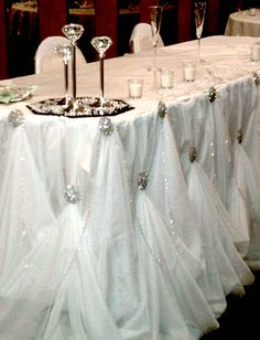 Magical wedding table draping design.