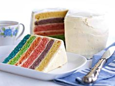 Paint this heavenly rainbow red velvet cake with multi-coloured brushstrokes! Enjoy this mouthwatering red velvet recipe, now in effervescent colours!