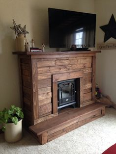 Pallet wood Faux Fireplace for electric fireplace.