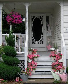 I love this screen door and all the pink flowers on the porch.