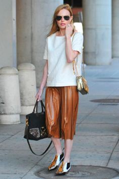 10 stylish ways to pair a shirt with a skirt: Kate Bosworth in pleated midi skirt and t-shirt. Shop all 10 of the outfits here: