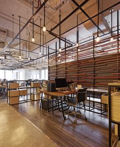 This space uses different floor coverings to define different areas