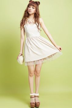 Dress made of terylene, featuring double slim straps, shirred design to back, bound waist, in mini length cut.