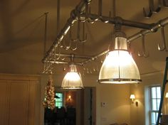 Industrial style stainless steel lights and pot hanging rack