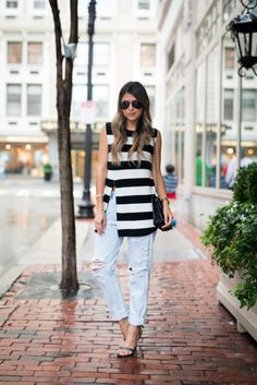 Loving this look on The Girl from Panama. A Banana Republic's Striped Sweater Tunic perfectly styled by adding distressed denim and strappy heels